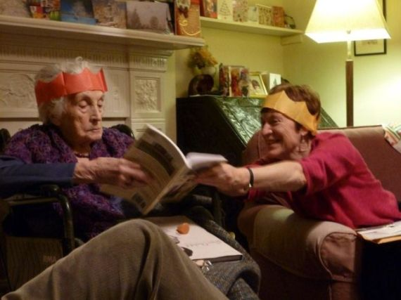 Tessa's Mom age 98 and sister look at Tessa's book